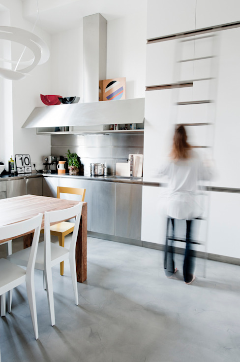 Industrial style houses by Cristina Meschi Architetto Industrial