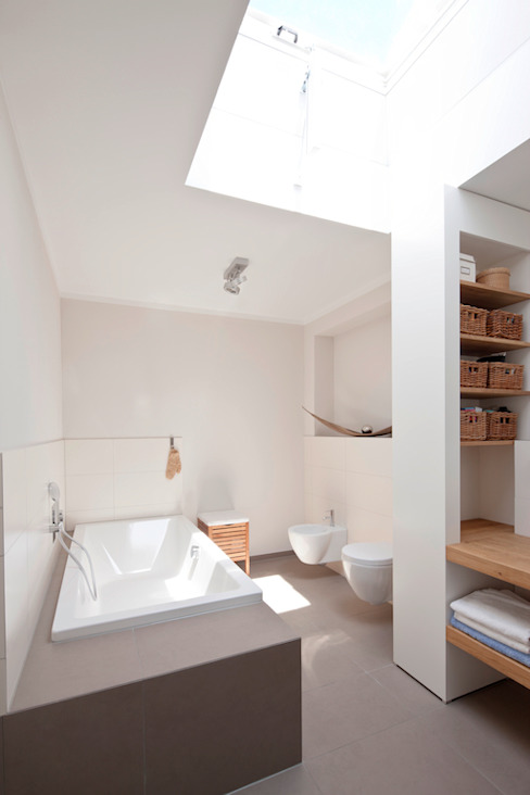 Baños de estilo  por in_design architektur,