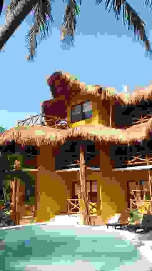 Hotel Holbox Dreams : Hoteles de estilo  por sandro bortot arquitecto, Tropical