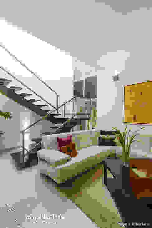 Casa Kopché Salones modernos de Grupo Arquidecture Moderno Arenisca