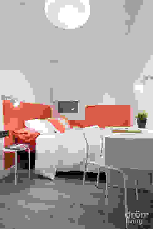 Dormitorio rojo de Dröm Living Escandinavo