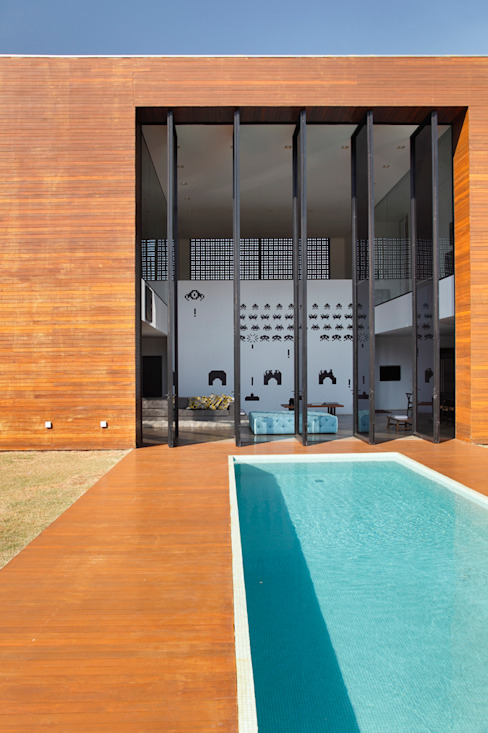 LA HOUSE Moderne Pools von STUDIO GUILHERME TORRES Modern