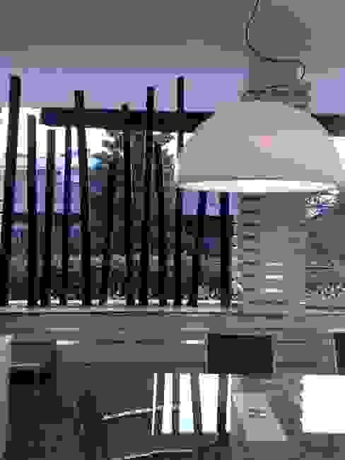 Fabio Valente Studio di architettura e urbanistica Balkon, Beranda & Teras Modern