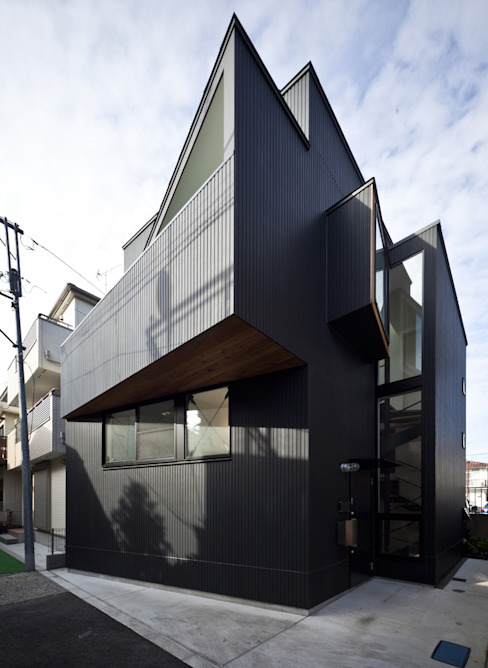 House in Shimomaruko de アトリエハコ建築設計事務所/atelier HAKO architects Moderno