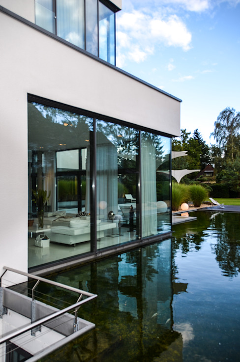 design@garten - Alfred Hart -  Design Gartenhaus und Balkonschraenke aus Augsburg의  주택, 모던