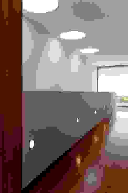 Casa GC: Casas  por Atelier Lopes da Costa,