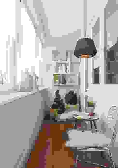 Terrazas de estilo  por Anna Clark Interiors