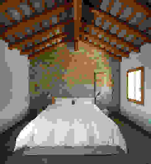 Casa Fiera Camera da letto moderna di Massimo Galeotti Architetto Moderno Laterizio