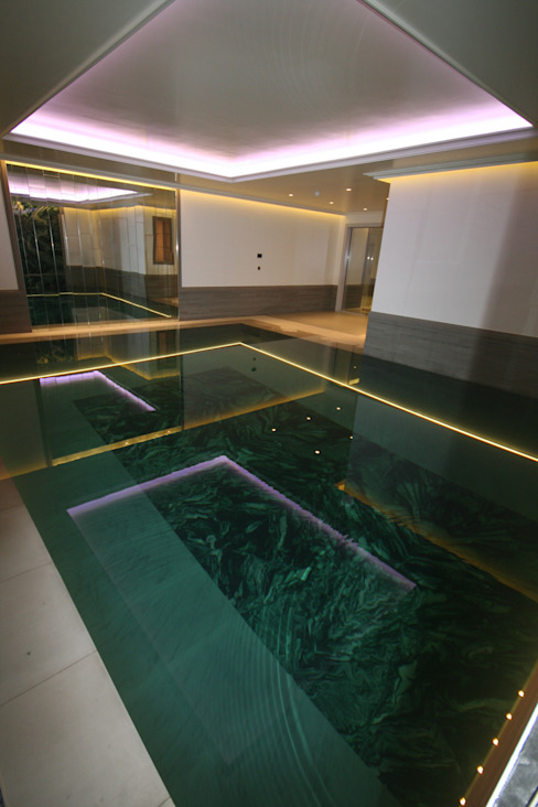 Indoor subterranean pool with movable floor:  Pool by Tanby Swimming Pools, Modern