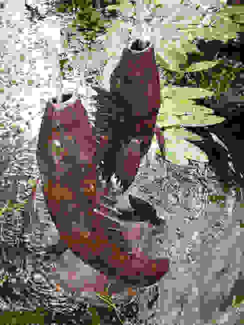 Koi Carp Fountian:  Artwork by Humphrey Bowden Fountain Designer and Maker,