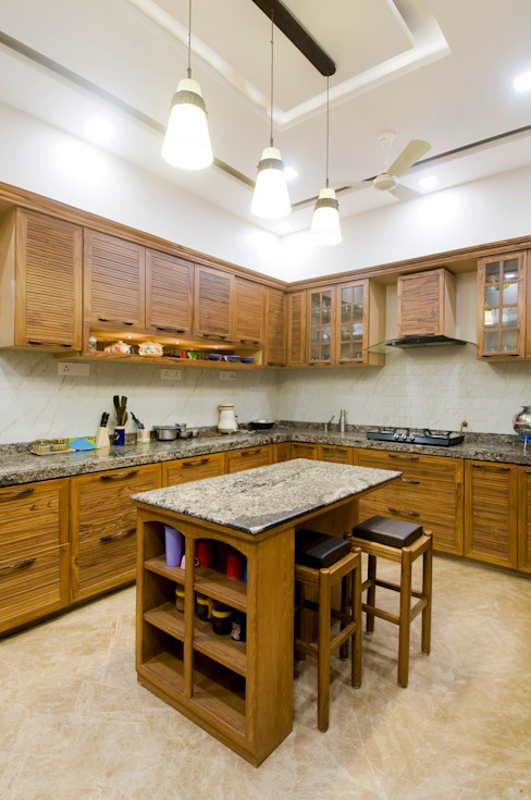 classic kitchen:  Kitchen by artha interiors private limited