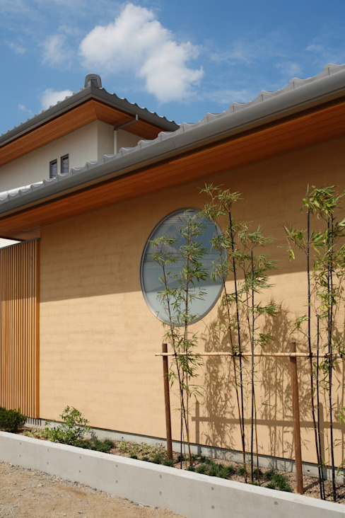 Casas de estilo ecléctico de ATELIER TAMA Ecléctico