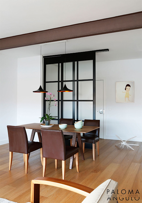 Dining room by Interiorismo Paloma Angulo