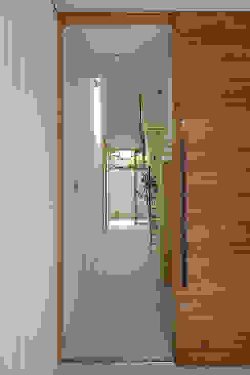 House in Gamagori: caico architect officeが手掛けたミニマリストです。,ミニマル