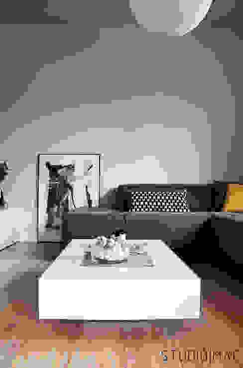 Realizacja projektu salonu w domu jednorodzinnym Eklektyczny salon od STUDIO MAC Eklektyczny