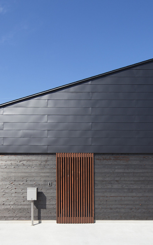 Casas modernas de 田村の小さな設計事務所 Moderno