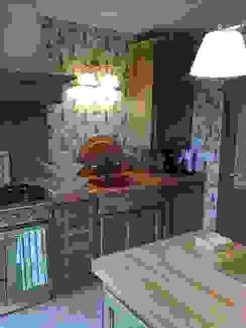 Cozinhas rústicas por Gamahogar Rústico