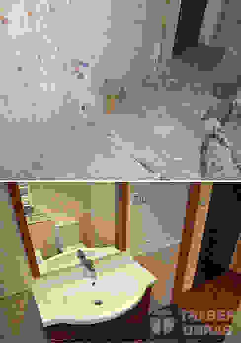 Reforma integral de vivienda por Traber Obras . Cuarto de baño antes y después. de Traber Obras