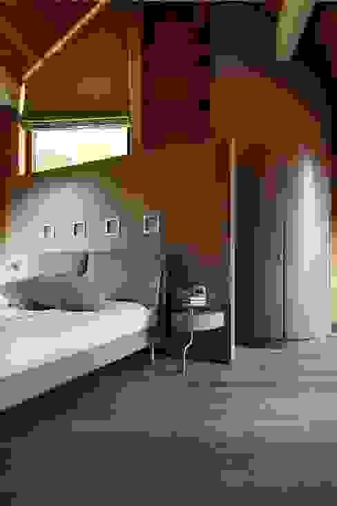 Dormitorios de estilo  por alberico & giachetti architetti associati, Moderno