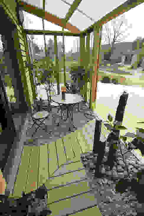 Jardines de invierno de estilo  por Patrice Bideau a.typique, Moderno