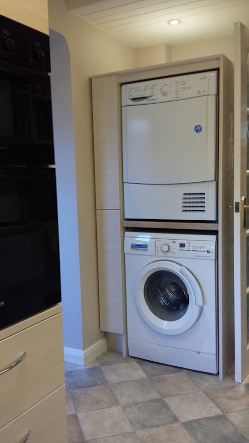 Stacking tumble dryer on washing machine by The Kitchen Makeover Shop Ltd