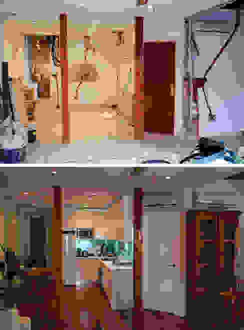 Reforma integral de vivienda en barrio de Chueca de Madrid por Traber Obras. Comedor antes y después. de Traber Obras