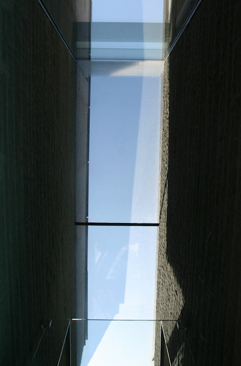 Janelas e portas modernas por NAT OFFICE - christian gasparini architect Moderno