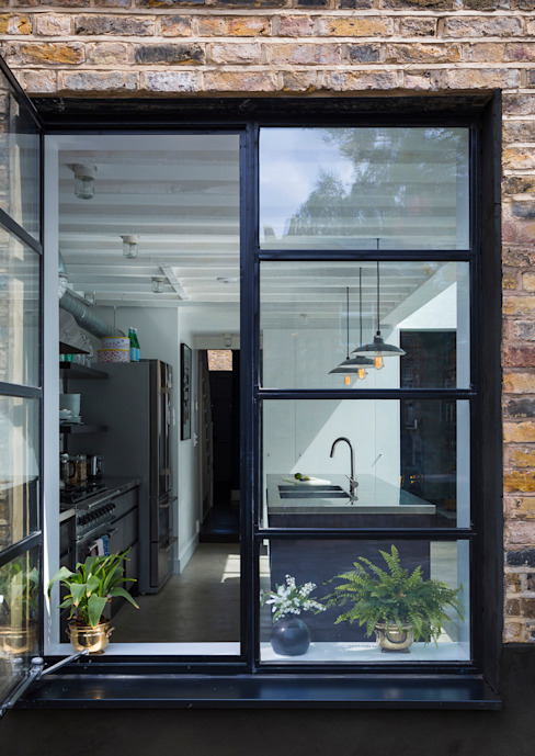 View through window to kitchen Industrial style houses by Mustard Architects Industrial