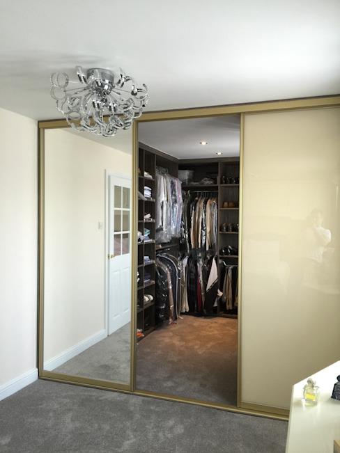Grey-Beige Zebrano walk-in wardrobe with gold frame sliding doors: modern  by Sliding Wardrobes World Ltd, Modern