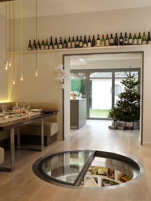 White Spiral Cellar with retractable round glass door homify Modern Home Wine Cellar