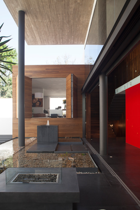 Casa Rinconda. Balcones y terrazas de estilo minimalista de Echauri Morales Arquitectos Minimalista