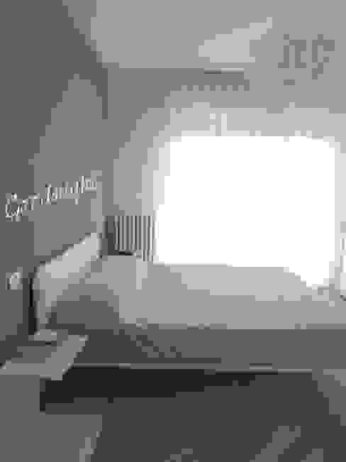 Appartamento per le vacanze Nadia Moretti Camera da lettoLetti e testate