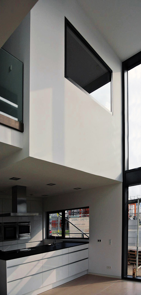unlimited architekten  |  neumann + rodriguez의  주방, 모던