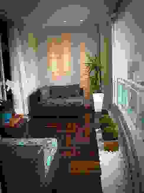 Sacada de apartamento: Terraços  por Eliegi Ambrosi Arquitetura e Design de Interiores,Mediterrâneo