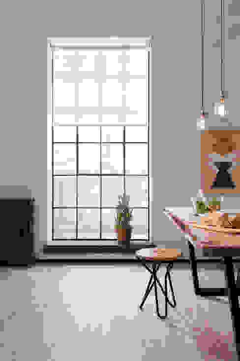 London Penthouse Apartment Comedores de estilo industrial de QMotion Industrial