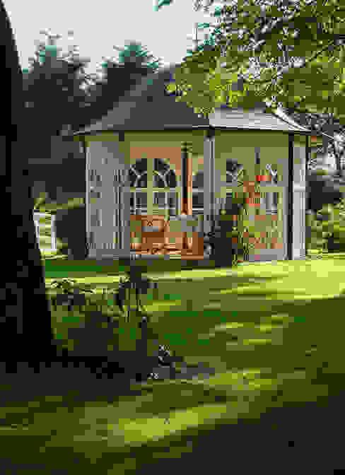 Classic style garden by WOGA Gartenpavillon Classic