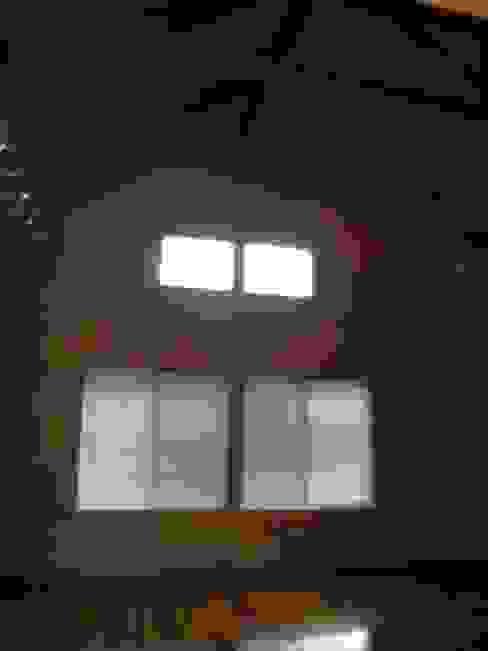 建築家の元自邸をリノベーションでさらに快適な空間に!: 株式会社リボーンキューブが手掛けた現代のです。,モダン
