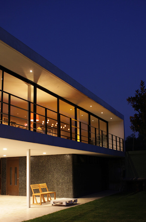 Houses by DF ARQUITECTOS, Modern