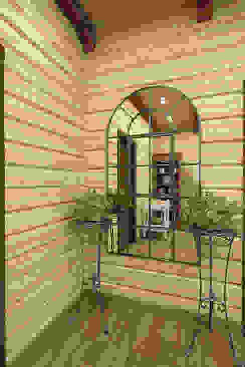 Дизайн-проект деревянного дома: Коридор и прихожая в . Автор – Студия дизайна и декора Светланы Фрунзе, Рустикальный