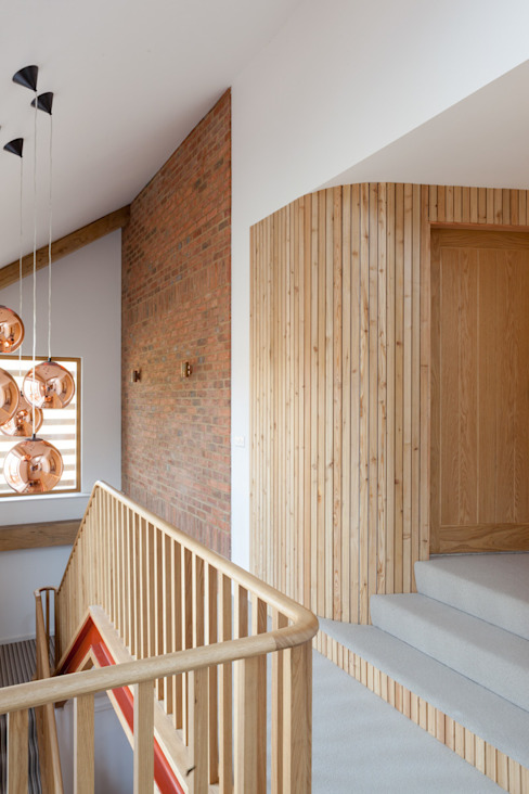 Curved larch leading to first floor bedroom Modern corridor, hallway & stairs by A-ZERO architects Modern
