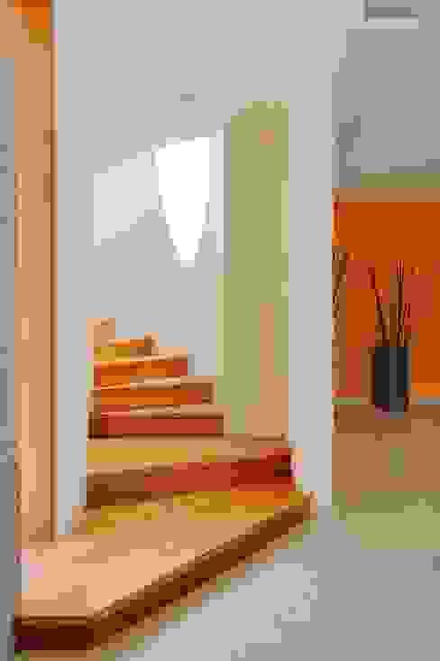 Projekty,  Korytarz, przedpokój zaprojektowane przez Excelencia en Diseño, Nowoczesny