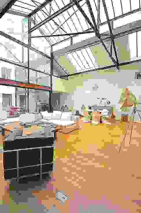Transformation ferronnerie en Loft/maison de ville Salle à manger moderne par Selig&Renault Moderne