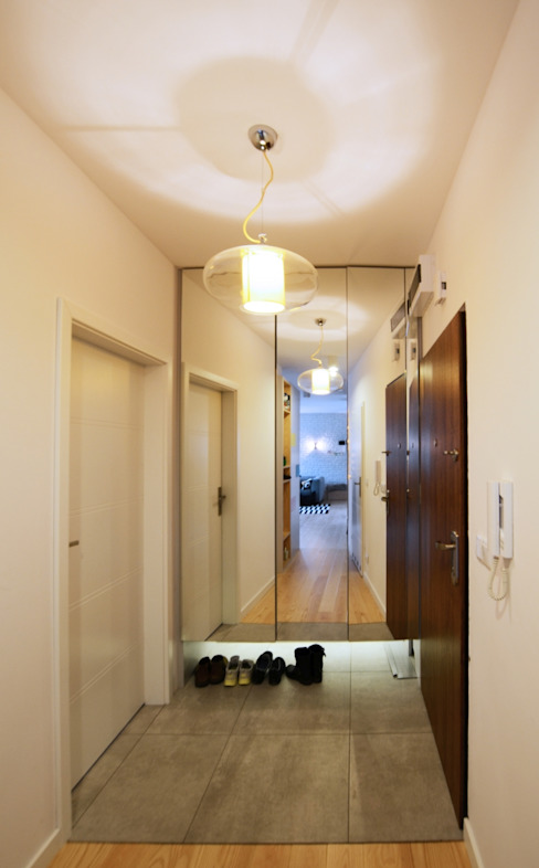 Couloir et hall d'entrée de style  par Devangari Design, Scandinave