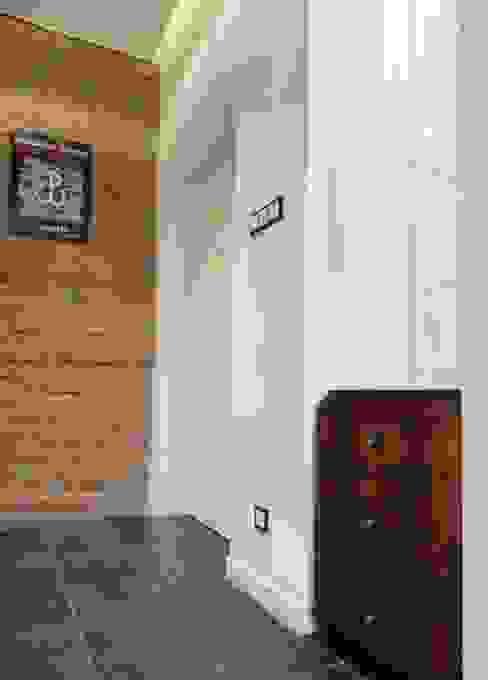 Kamienica na Puławskiej : styl , w kategorii Korytarz, przedpokój zaprojektowany przez Devangari Design,Eklektyczny