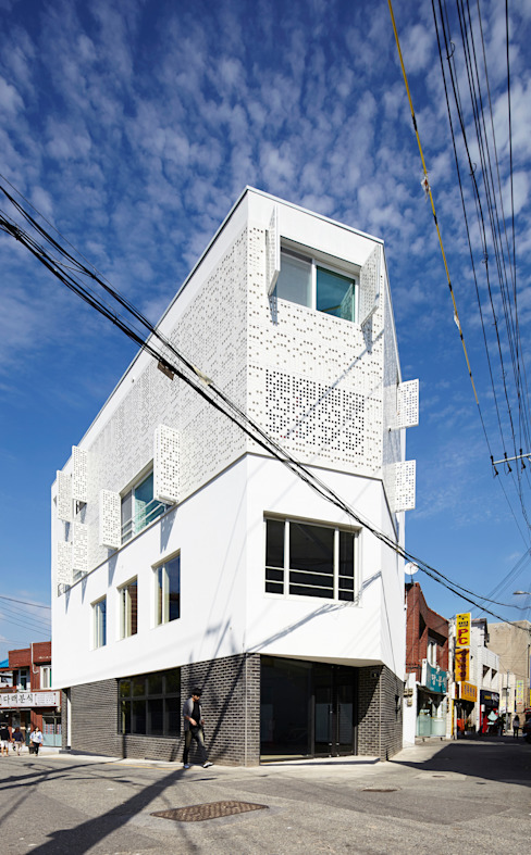 Casas de estilo  por 스마트건축사사무소, Moderno