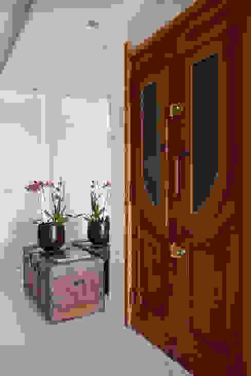 Hall de entrada Corredores, halls e escadas ecléticos por Da.Hora Arquitetura Eclético