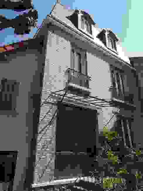 Maison agrandie et rénovée de tous cotés Maisons classiques par agence MGA architecte DPLG Classique