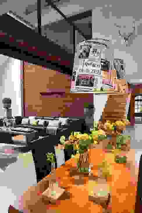 Salas de jantar industriais por RAJEK Projektowanie Wnętrz Industrial