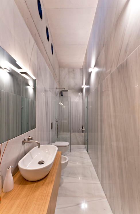 Banheiros minimalistas por Ascoz Arquitectura Minimalista