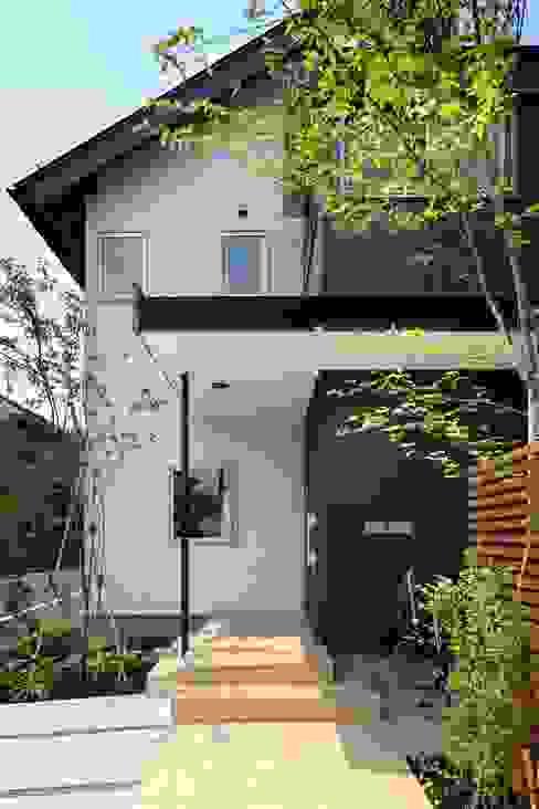 Casas de estilo moderno de TAMAI ATELIER Moderno